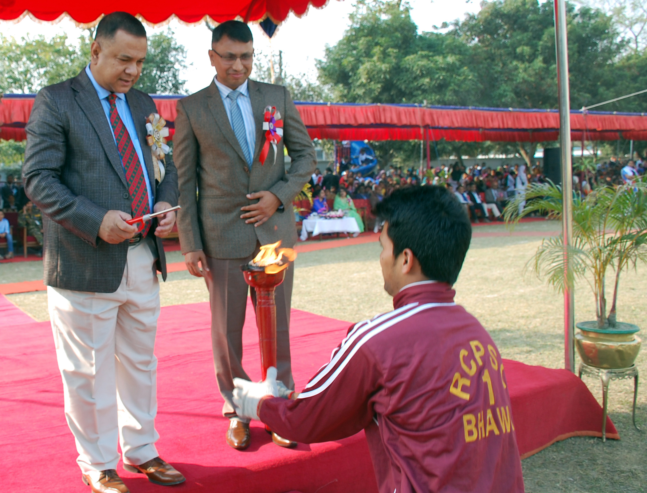 The chief guest is lighting a torch in the annual sports and prize giving program, 2018